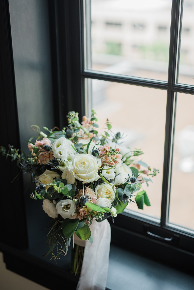 white, blush, and dusty blue bouquet