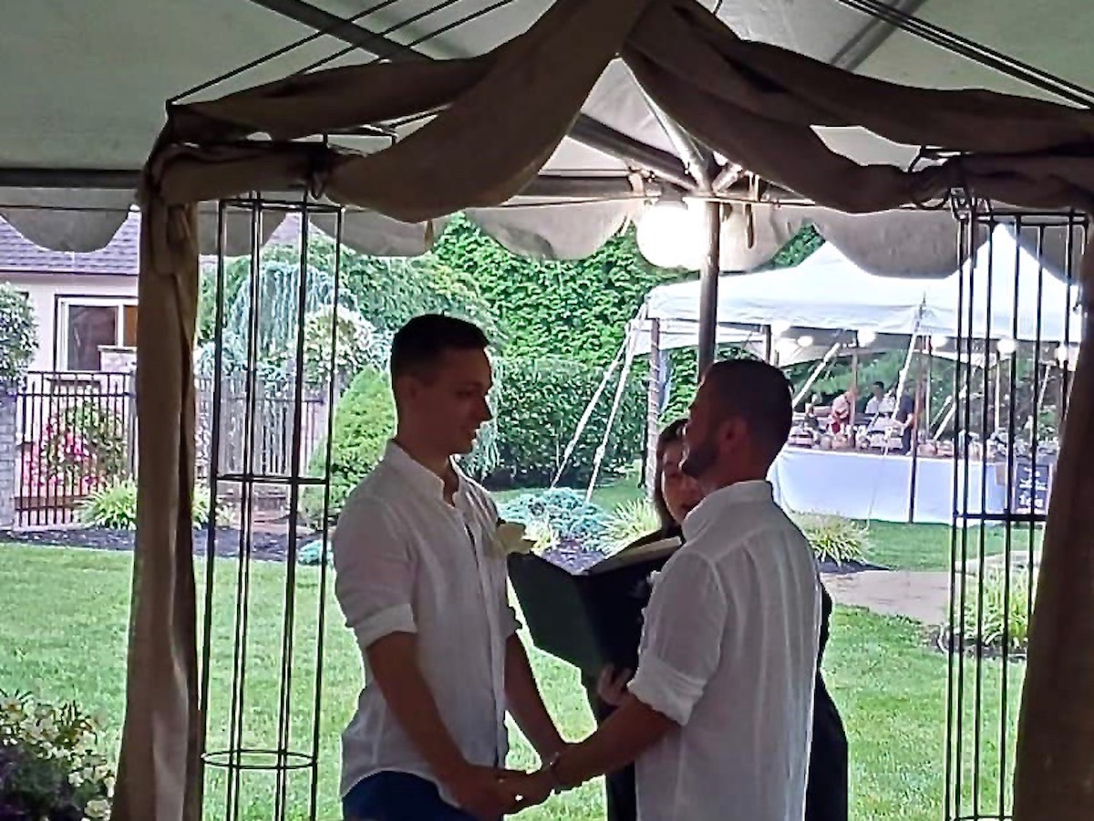 Grooms Exchange Vows