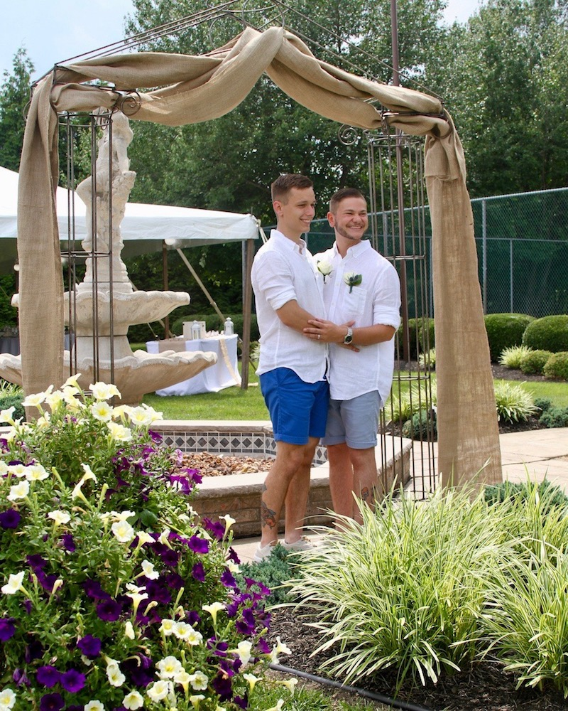 Grooms Under Arch / Photo Credit MG Photography
