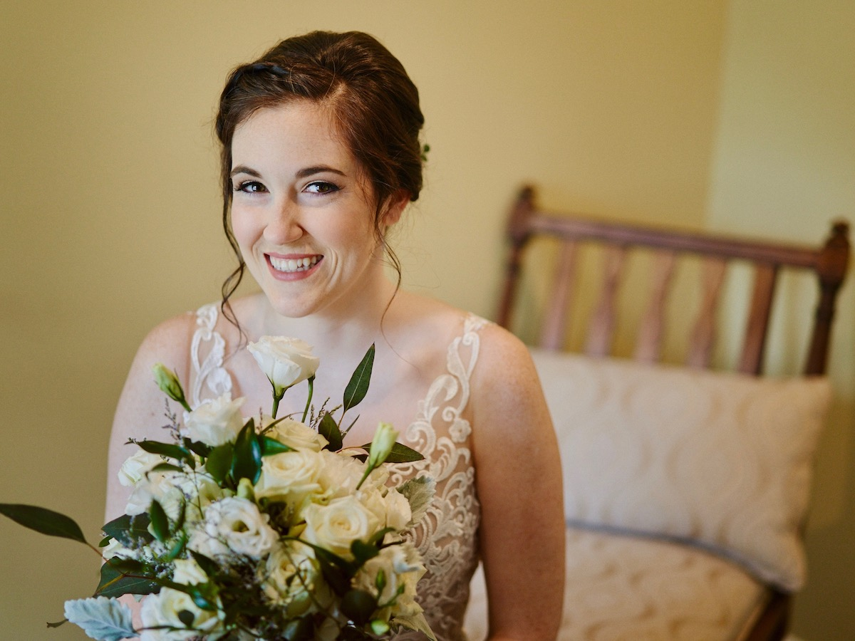 Lovely bride with white bouquet